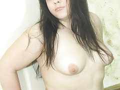 Plump young girlie exposes her little shaven pinkie