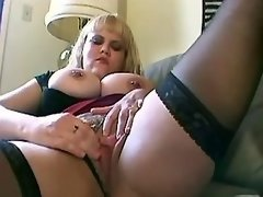 Blonde with huge boobs teases pussy