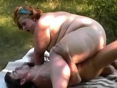 Elephant size woman fucks on grass