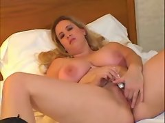 Honey fatty plays w toy in bedroom