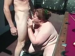 Enormous woman does blowjob outdoor