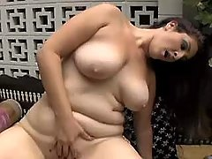 Brunette plumper jumps on cock and sucks him