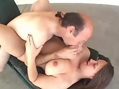 Chubby brunette girl sucking cock